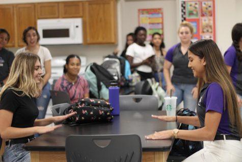 Senior Class President Lauren Menchaca, left, and Student Body President Summer Sullivan demonstrate the student council clap.