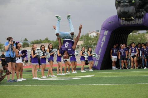 PHOTO BY NOELEE AGUILAR, 12   Senior Gabriel Stonewall lands a backflip after being announced at this years Meet the Cougars. The event was held on August 21 in Cougar Stadium. The event honors students in Football, Cheerleading, Student Council, Band, Flags, Fusion, Silver Starz and Forte.