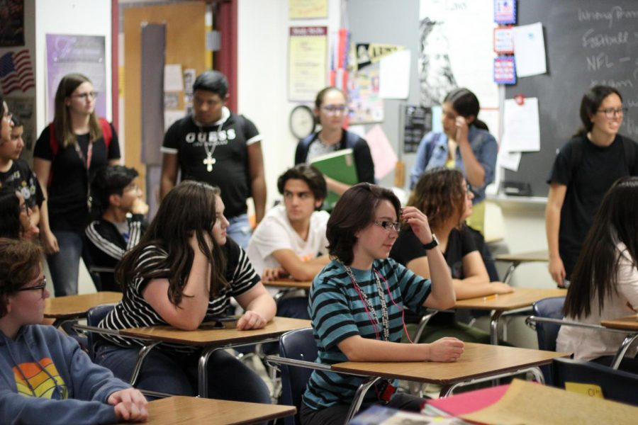 Students listen to information presented at first meeting.  Photo by Isabella Eschbach, 11