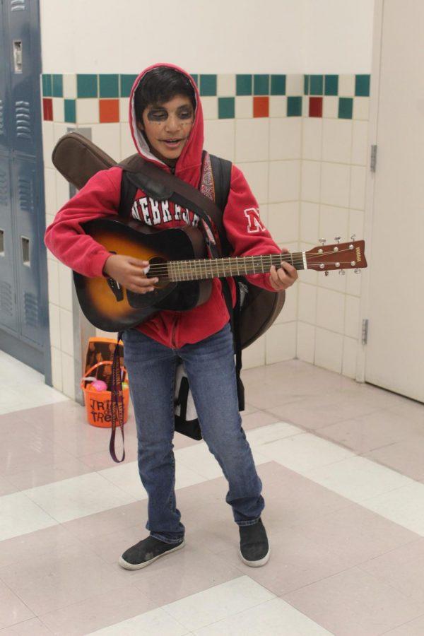 Costume contest winner, freshman Angel Escalante, performs 'Un Poco Loco' from the film