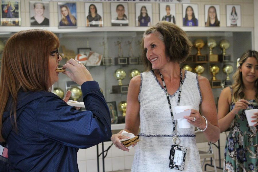 English teachers Shannon Devereaux - Burciaga and Amy Moyes eat cookies and chat over coffee on Monday, August 9 in the foyer of the Main Gym.
